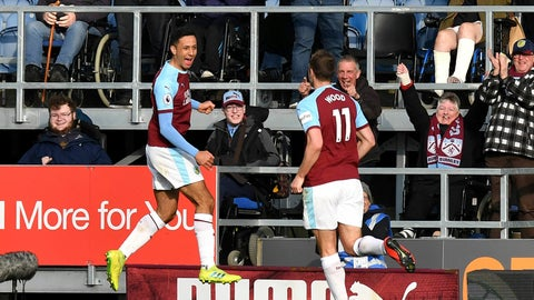 <p>               Burnley's Dwight McNeil, left, celebrates scoring his side's second goal of the game during the English Premier League soccer match between Burnley and Wolverhampton Wanderers at the Turf Moor stadium, Burnley, England. Saturday, March. 30, 2019. (Anthony Devlin/PA via AP)             </p>
