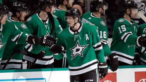 <p>               Dallas Stars defenseman John Klingberg (3) is congratulated by the bench after scoring against the Florida Panthers in the second period of an NHL hockey game in Dallas, Tuesday, March 19, 2019. (AP Photo/Tony Gutierrez)             </p>