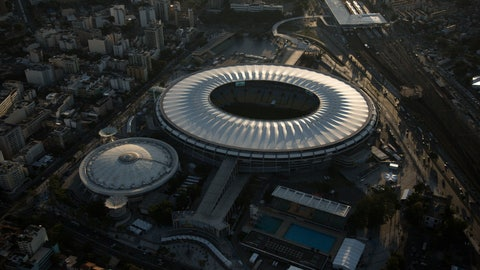 <p>               FILE - This June 8, 2014 file photo, shows an aerial view of the Maracana stadium, in Rio de Janeiro, Brazil. Rio de Janeiro's state government announced on Monday, March 18, 2019 that it will take back the control of the crisis-ridden Maracana stadium and break the contract with its private administrators. (AP Photo/Felipe Dana, File)             </p>