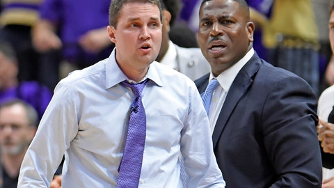<p>               In this photo taken Feb. 23, 2019, LSU head coach Will Wade, left, and assistant coach Tony Benford, right, watch the second half of an NCAA college basketball game in Baton Rouge, La. Benford has been named interim head coach after Wade was suspended amid concerns about the recruiting tactics he used to build his team. (AP Photo/Bill Feig)             </p>
