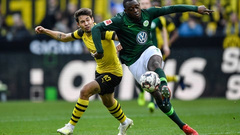 <p>               Wolfsburg's Jerome Roussillon, right, and Dortmund's Raphael Guerreiro challenge for the ball during the German Bundesliga soccer match between Borussia Dortmund and VfL Wolfsburg in Dortmund, Germany, Saturday, March 30, 2019. (AP Photo/Martin Meissner)             </p>