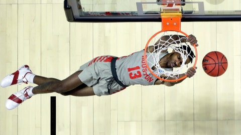 <p>               Houston's DeJon Jarreau dunks the ball during the first half of a first round men's college basketball game against Georgia State in the NCAA Tournament Friday, March 22, 2019, in Tulsa, Okla. (AP Photo/Jeff Roberson)             </p>