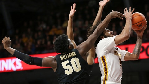 <p>               Minnesota's forward Jordan Murphy goes up to the basket against Purdue's Trevion Williams during the first half of an NCAA basketball game Tuesday, March 5, 2019, in Minneapolis. (AP Photo/Stacy Bengs)             </p>