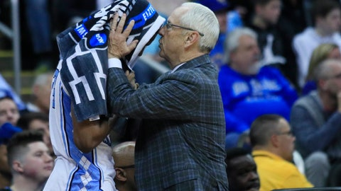 <p>               North Carolina head coach Roy Williams, right, talks with Kenny Williams during the second half of a men's NCAA tournament college basketball Midwest Regional semifinal game against Auburn Friday, March 29, 2019, in Kansas City, Mo. (AP Photo/Orlin Wagner)             </p>