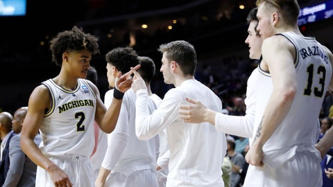 <p>               Michigan guard Jordan Poole (2) celebrates with teammates at the end of a second round men's college basketball game against Florida in the NCAA Tournament, Saturday, March 23, 2019, in Des Moines, Iowa. Michigan won 64-49. (AP Photo/Charlie Neibergall)             </p>