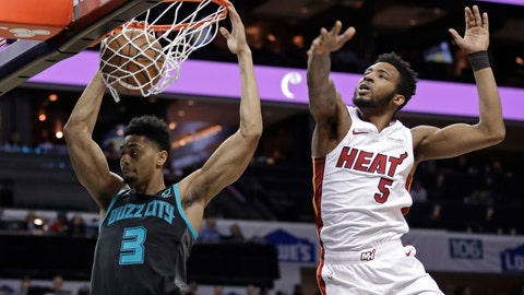 <p>               Charlotte Hornets' Jeremy Lamb (3) dunks against Miami Heat's Derrick Jones Jr. (5) during the first half of an NBA basketball game in Charlotte, N.C., Wednesday, March 6, 2019. (AP Photo/Chuck Burton)             </p>