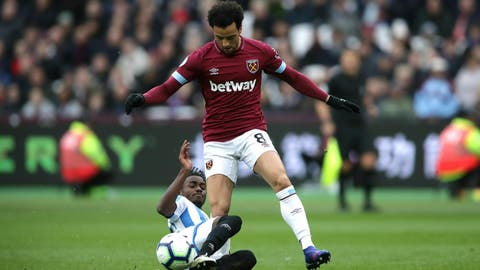 <p>               Huddersfield Town's Aaron Rowe, left, and West Ham United's Felipe Anderson battle for the ball during the English Premier League soccer match between West Ham United and Huddersfield Town at London Stadium in London, Saturday, March 16, 2019. (John Walton/PA via AP)             </p>