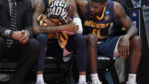 <p>               Murray State's Ja Morant, left is consoled by teammate Murray State's Shaq Buchanan, right, during the second half of a second round men's college basketball game against Florida State in the NCAA tournament, Saturday, March 23, 2019, in Hartford, Conn. (AP Photo/Jessica Hill)             </p>