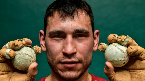 "<p>               In this Tuesday, March 5, 2019 photo, Diego Iturriaga, 27, a player of Basque Ball known as ""pelotari"", holds Basque Balls as he poses for a photo at Labrit court or fronton, in Pamplona, northern Spain. With their hands protected by layers of tightly-bound tape, the players take turns swatting a small, hard ball at speeds that reach 115 kilometers (71.4 miles) per hour. (AP Photo/Alvaro Barrientos)             </p>"