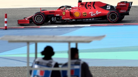 <p>               Ferrari driver Sebastian Vettel of Germany steers his car during the third free practice at the Formula One Bahrain International Circuit in Sakhir, Bahrain, Saturday, March 30, 2019. The Bahrain Formula One Grand Prix will take place on Sunday. (AP Photo/Hassan Ammar)             </p>
