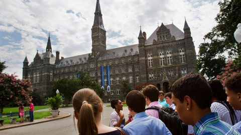 <p>               FILE - In this July 10, 2013, file photo, prospective students tour Georgetown University's campus in Washington. Federal authorities have charged college coaches and others in a sweeping admissions bribery case in federal court. The racketeering conspiracy charges were unsealed Tuesday, March 12, 2019, against the coaches at schools including Georgetown, Wake Forest University and the University of Southern California. Authorities say the coaches accepted bribes in exchange for admitting students as athletes, regardless of their ability. (AP Photo/Jacquelyn Martin, File)             </p>