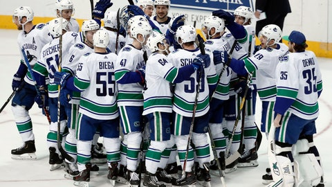 <p>               The Vancouver Canucks gather on the ice to celebrate with Josh Leivo, far right in group, after Leivo scored a shootout goal against the Dallas Stars in an NHL hockey game in Dallas, Sunday, March 17, 2019. The Canucks won 3-2. (AP Photo/Tony Gutierrez)             </p>