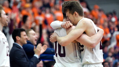 <p>               Colgate forward Rapolas Ivanauskas, right, hugs forward Will Rayman in the closing seconds of the team's NCAA college basketball game against Bucknell for the championship of the Patriot League men's tournament in Hamilton, N.Y., Wednesday, March 13, 2019. Colgate won 94-80. (AP Photo/Adrian Kraus)             </p>