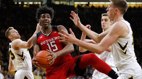 <p>               Rutgers center Myles Johnson (15) grabs a rebound between Iowa's Jordan Bohannon, left, Nicholas Baer and Joe Wieskamp, right, during the first half of an NCAA college basketball game, Saturday, March 2, 2019, in Iowa City, Iowa. (AP Photo/Charlie Neibergall)             </p>