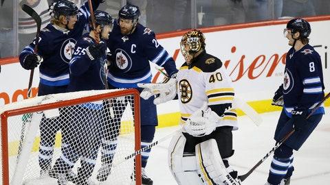 <p>               Winnipeg Jets' Patrik Laine (29), Mark Scheifele (55), Blake Wheeler (26) and Jacob Trouba (8) celebrate Scheifele's goal on Boston Bruins goaltender Tuukka Rask (40) during the first period of an NHL hockey game Thursday, March 14, 2019, in Winnipeg, Manitoba. (John Woods/The Canadian Press via AP)             </p>