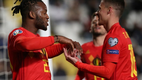<p>               Belgium player Michy Batshuayi, left, celebrates a goal against Cyprus during the Euro 2020 group I qualifying soccer match between Cyprus and Belgium at the GSP stadium in Nicosia, Cyprus, Sunday, March 24, 2019. (AP Photo/Philippos Christou)             </p>