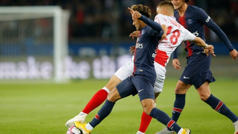 <p>               FILE - In this Sept. 26, 20-19 file picture PSG's Neymar, left, fights for the ball with Reims' Remi Oudin during the French League One soccer match between Paris-Saint-Germain and Reims at the Parc des Princes stadium in Paris, France. Fifth-placed Reims's excellent run in the French league is largely due to the performances of 22-year-old Remi Oudin, a versatile attacking midfielder with an impressive left foot and a great touch. (AP Photo/Michel Euler, File)             </p>