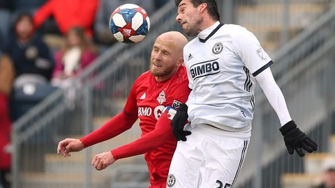 <p>               Toronto FC midfielder Michael Bradley (4) battles Philadelphia Union midfielder midfielder Ilsinho (25) for a header in the first half of an MLS soccer match in Chester, Pa., Saturday, March 2, 2019. (AP Photo/Rich Schultz)             </p>