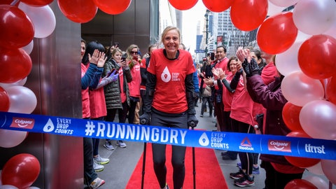 <p>               This Feb. 11, 2019, photo provided by Colgate, shows ultra-marathoner and water activist Mina Guli, aided by canes, approaching a ceremonial finish line in New York. Gulia came close to running 100 marathons in 100 days over sever continents, all in an effort to raise awareness about global water shortages and how to prevent them. (Kelvin Trautman/Colgate via AP)             </p>