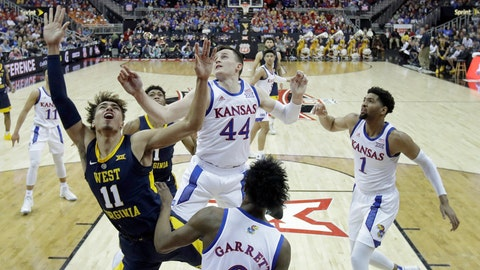<p>               West Virginia's Emmitt Matthews Jr. (11) gets past Kansas' Mitch Lightfoot (44) to put up a shot during the first half of an NCAA college basketball game in the Big 12 men's tournament Friday, March 15, 2019, in Kansas City, Mo. (AP Photo/Charlie Riedel)             </p>