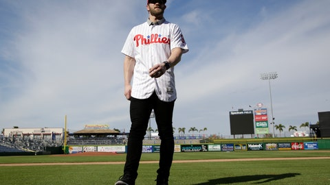 <p>               Bryce Harper walks on the field after being introduced as a Philadelphia Phillies player during a news conference at the team's spring training baseball facility, Saturday, March 2, 2019, in Clearwater, Fla. Harper and the Phillies agreed to a $330 million, 13-year contract, the largest deal in baseball history. (AP Photo/Lynne Sladky)             </p>