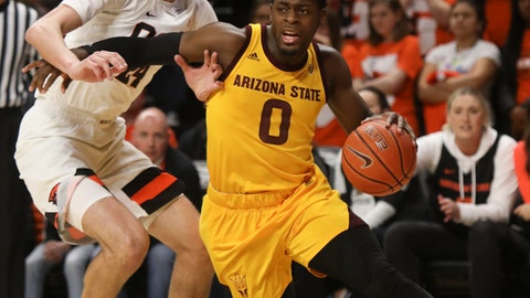 <p>               Arizona State's Luguentz Dort (0) drives to the basket, past Oregon State's Kylor Kelley (24) during the first half of an NCAA college basketball game in Corvallis, Ore., Sunday, March 3, 2019. (AP Photo/Amanda Loman)             </p>
