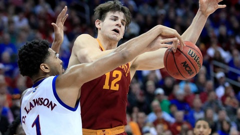 <p>               Kansas forward Dedric Lawson (1) blocks a shot by Iowa State forward Michael Jacobson (12) during the second half of an NCAA college basketball game in the final of the Big 12 men's tournament in Kansas City, Mo., Saturday, March 16, 2019. (AP Photo/Orlin Wagner)             </p>