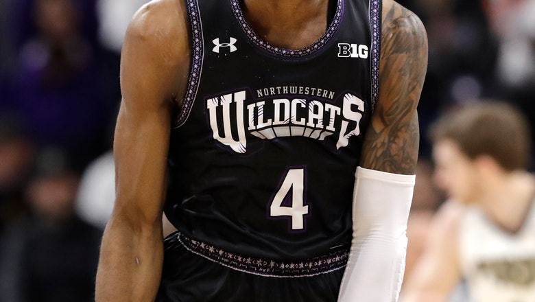 Northwestern's Law carried off court with leg injury
