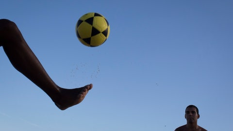"<p>               FILE - In this May 31, 2014 file photo, a player controls a ball during a game of ""altinho,"" where the goal is to keep the ball airborne while passed amid players, on Ipanema beach in Rio de Janeiro, Brazil. The joint candidacy for the 2030 World Cup soccer tournament, presented by Argentina, Chile, Paraguay and Uruguay, was announced on Wednesday, March 20, 2019 in Buenos Aires during a meeting of those South American nations' leaders. (AP Photo/Felipe Dana, File)             </p>"