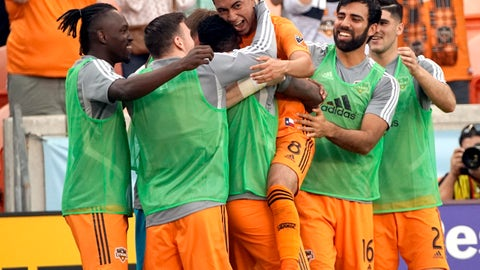 <p>               Houston Dynamo's Memo Rodriguez (8) celebrates with teammates after scoring a goal against the Montreal Impact during the first half of an MLS soccer match Saturday, March 9, 2019, in Houston. (AP Photo/David J. Phillip)             </p>