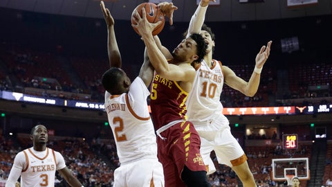 <p>               Iowa State guard Lindell Wigginton (5) drives to the basket against Texas guard Matt Coleman III (2) and forward Jaxson Hayes (10) during the first half of an NCAA college basketball game, Saturday, March 2, 2019, in Austin, Texas. (AP Photo/Eric Gay)             </p>