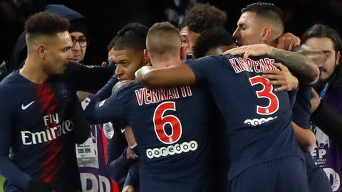 <p>               Teammates congratulate PSG's Kylian Mbappe, second left, after he scored his side's first goal during their French League One soccer match between Paris-Saint-Germain and Olympique Marseille at the Parc des Princes stadium in Paris, Sunday, March 17, 2019. (AP Photo/Christophe Ena)             </p>