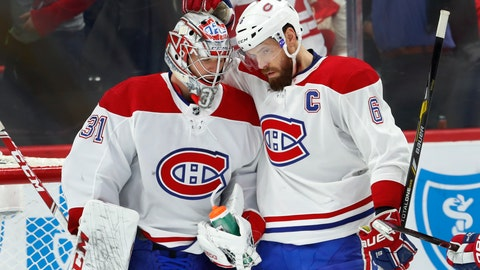 <p>               Montreal Canadiens goaltender Carey Price (31) celebrates with Shea Weber (6) after beating the Detroit Red Wings 8-1 after an NHL hockey game, Tuesday, Feb. 26, 2019, in Detroit. (AP Photo/Paul Sancya)             </p>