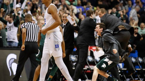 <p>               Duke forward Javin DeLaurier (12) walks past Michigan State bench who begin celebrating their win at the end of the NCAA men's East Regional final college basketball game in Washington, Sunday, March 31, 2019. (AP Photo/Alex Brandon)             </p>
