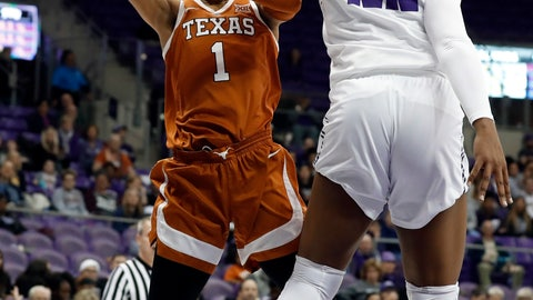 <p>               Texas guard Sug Sutton (1) has her shot blocked by TCU center Jordan Moore (22) during the first half of an NCAA college basketball game in Fort Worth, Texas, Tuesday, March 5, 2019. (AP Photo/Tony Gutierrez)             </p>