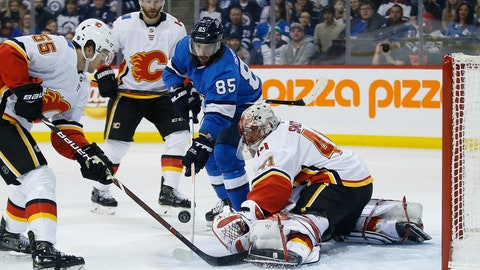 <p>               Winnipeg Jets' Mathieu Perreault (85) scores on Calgary Flames goaltender Mike Smith (41) during the second period of an NHL game in Winnipeg, Manitoba, Saturday, March 16, 2019. (John Woods/The Canadian Press via AP)             </p>