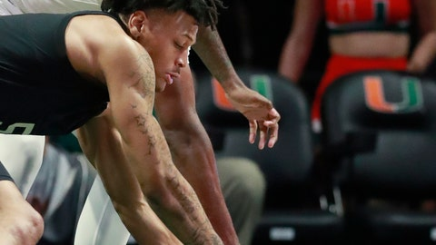 <p>               Pittsburgh guard Au'Diese Toney (5) and Miami guard Anthony Lawrence II (3) battle for a loose ball during the first half of an NCAA college basketball game, Tuesday, March 5, 2019, in Coral Gables, Fla. (AP Photo/Wilfredo Lee)             </p>