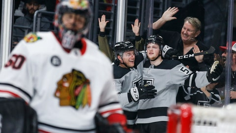 <p>               Los Angeles Kings forward Austin Wagner (51) celebrates his goal with forward Jonny Brodzinski (76) during the second period of an NHL hockey game against Chicago Blackhawks on Saturday, March 30, 2019, in Los Angeles. (AP Photo/Ringo H.W. Chiu)             </p>