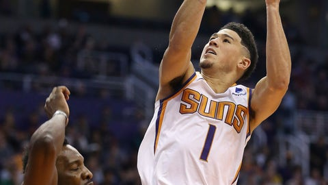 <p>               Phoenix Suns guard Devin Booker (1) gets a shot off and is fouled by Washington Wizards forward Jeff Green, left, during the first half of an NBA basketball game Wednesday, March 27, 2019, in Phoenix. (AP Photo/Ross D. Franklin)             </p>