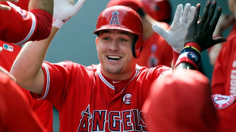 <p>               FILE - In this Sept. 10, 2017, file photo, Los Angeles Angels' Mike Trout is greeted in the dugout after hitting a solo home run in the first inning of a baseball game against the Seattle Mariners in Seattle. A person familiar with the negotiations tells The Associated Press Tuesday, March 19, 2019, that Trout and the Angels are close to finalizing a record $432 million, 12-year contract that would shatter the record for the largest deal in North American sports history.  (AP Photo/Ted S. Warren, File)             </p>