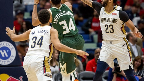 <p>               Milwaukee Bucks forward Giannis Antetokounmpo (34) goes up against New Orleans Pelicans forward Anthony Davis (23) and guard Kenrich Williams (34) in the first half of an NBA basketball game in New Orleans, Tuesday, March 12, 2019. (AP Photo/Scott Threlkeld)             </p>