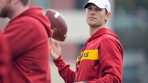 <p>               This Tuesday, March 5, 2019 photo provided by University of Southern California Athletics shows new USC offensive coordinator Graham Harrell. Harrell stepped into one of the highest-profile assistant jobs in college football after Kliff Kingsbury left USC without calling a play. The Trojans' new offensive coordinator is working hard to get up to speed in spring practice. (John McGillen/USC Athletics via AP)             </p>
