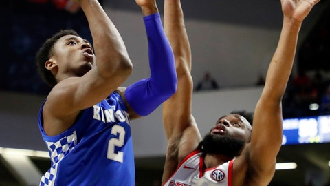 <p>               Kentucky guard Ashton Hagans (2) shoots next to Mississippi guard D.C. Davis (20) during the second half of an NCAA college basketball game in Oxford, Miss., Tuesday, March 5, 2019. Kentucky won 80-76. (AP Photo/Rogelio V. Solis)             </p>