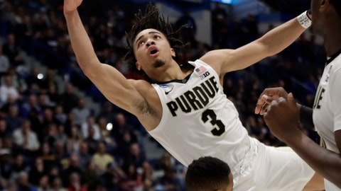 <p>               Purdue's Carsen Edwards (3) drives and is fouled by Villanova's Phil Booth (5) during the first half of a second round men's college basketball game in the NCAA Tournament, Saturday, March 23, 2019, in Hartford, Conn. (AP Photo/Elise Amendola)             </p>