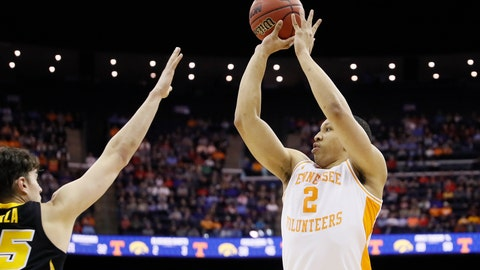 <p>               Tennessee's Grant Williams (2) shoots over Iowa's Luka Garza (55) In the second half during a second-round men's college basketball game in the NCAA Tournament, Sunday, March 24, 2019, in Columbus, Ohio. (AP Photo/John Minchillo)             </p>