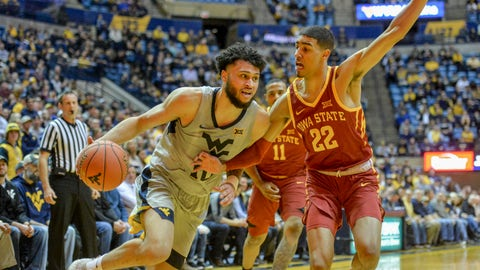 <p>               West Virginia guard Jermaine Haley (10) works the ball past Iowa State guard Tyrese Haliburton (22) during the first half of an NCAA college basketball game Wednesday, March 6, 2019, in Morgantown, W.Va. (William Wotring/The Dominion-Post via AP)             </p>