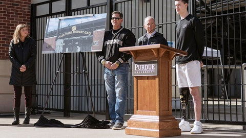 <p>               In this photo provided by Purdue University, Sean English, right, the inaugural recipient of the Tyler Trent Courage and Resilience Award, speaks as Tyler's parents Kelly, left, and Tony Trent, and Purdue President Mitch Daniels look on during a news conference at the entrance of Ross-Ade Stadium, Wednesday, March 27, 2019, in West Lafayette, Ind. A rendering of the memorial gate honoring Tyler Trent at the entrance of Ross-Ade Stadium is displayed between the couple. (Rebecca Wilcox/Purdue University via AP)             </p>