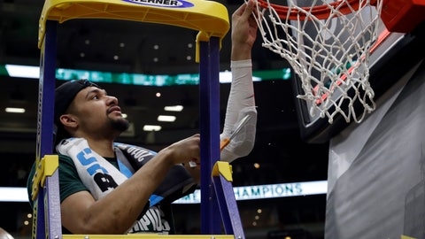 <p>               Michigan State's Kenny Goins cuts a piece of the net after defeating Michigan 65-60 in an NCAA college basketball championship game in the Big Ten Conference tournament, Sunday, March 17, 2019, in Chicago. (AP Photo/Nam Y. Huh)             </p>