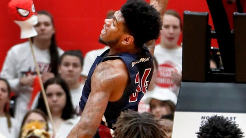 <p>               Fairleigh Dickinson's Mike Holloway Jr. (34) dunks past St. Francis Pa.'s Keith Braxton (13) during the first half of an NCAA college basketball game for the championship of the Northeast Conference men's tournament, Tuesday, March 12, 2019, in Pittsburgh. (AP Photo/Keith Srakocic)             </p>