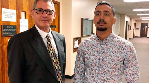 <p>               Mixed martial arts fighter Arnold Berdon, right, and his attorney Myles Breiner stand outside a courtroom in Honolulu on Thursday, March 14, 2019. Berdon pleaded no contest to assaulting his wife and fellow fighter, Rachael Ostrovich Berdon, who filed for a temporary restraining order in November 2018, alleging he punched her in the face, fracturing her eye socket. (AP Photo/Jennifer Sinco Kelleher)             </p>